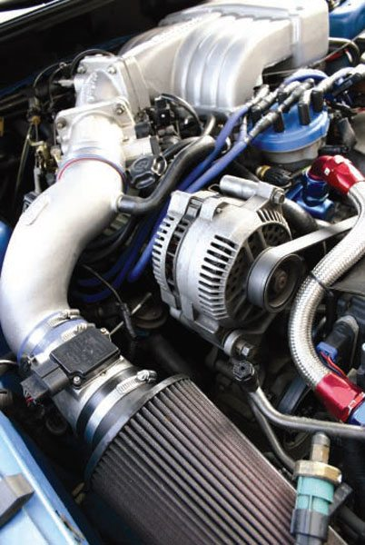 """The """"dry"""" intake tract of a modern fuel-injected engine shown from filter to throttle body to manifold. Fuel is not added until just before the air enters the cylinders, allowing for more convoluted path design without puddling. (Nate Tovey)"""