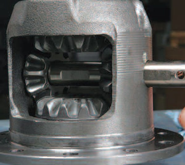 As long as the pinions are lined up correctly, the differential pin will slide smoothly in place. It is best to check this alignment now before the ring gear is installed.