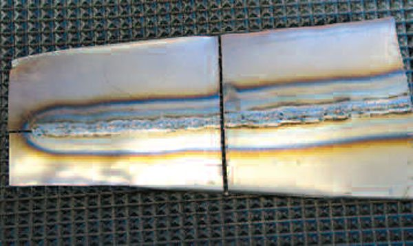 The critical underside of the practice weld fully penetrates the metal. The object is to achieve that penetration, without excessive heat that burns through, or distorts, the panel and patches. Practice welds allow you to optimize welder settings and to perfect technique.