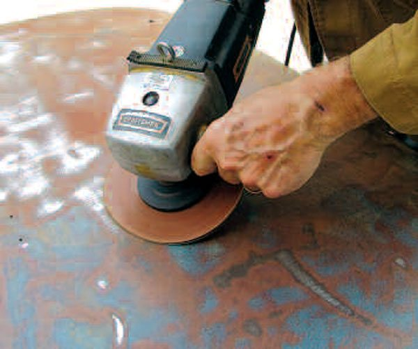 Disc sanding works well to remove paint and rust from body panels. You have to be careful with this technique not to overheat metal and warp it. Done properly, disc sanding is a slow metal-cleaning method.