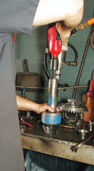 Now you can thread the lead screw and the tool draws the bearing off the pinion head as you tighten the bolt. Here, we are using an air impact gun to rapidly remove thread the lead screw. This is similar to the function of most typical bearing pullers. (Randall Shafer)
