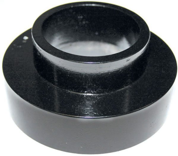 This is a typical coil-spring spacer, to be mounted in the spring pocket below the coil. It can be a useful tool when adjusting ride height.