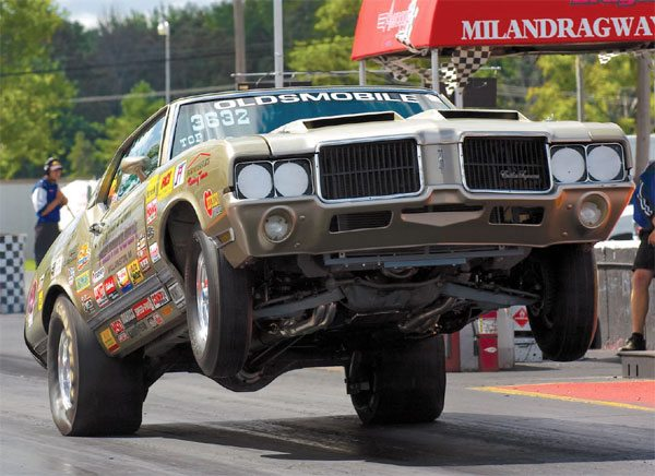 Chris and Linda Heminger's 1971 Olds Cutlass gets the wheels up more than a foot on launch. This is about the maximum height you'd ever want to achieve before the vehicle weight begins to transfer backward. At this level, it's still moving up and forward at the same time.