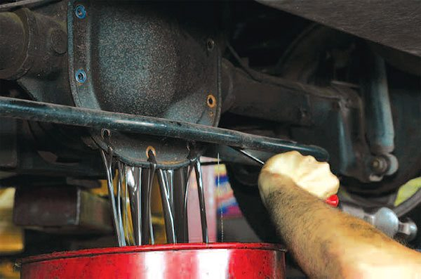 Once all of the cover bolts have been removed, a little persuasion with a screwdriver and hammer is often required to separate the cover from the housing. Just a light tap with the hammer usually does the trick. (Randall Shafer)