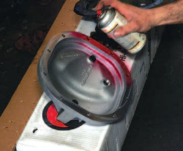 Some gasket adhesive is applied to the cover surface, so the gasket stays in place during installation for a good seal. (Randall Shafer)