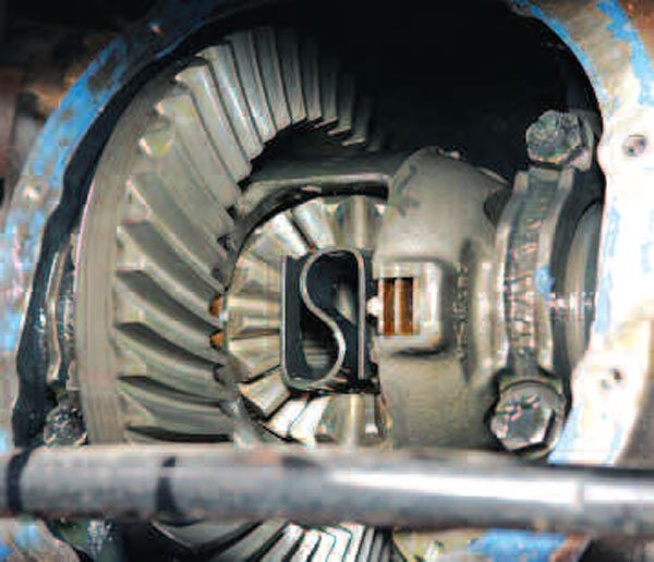 Once the cover is removed, you get your first glimpse on the internals of the axle. The ring gear is on the left, and the differential is bolted in place. This is a Ford-style traction lock differential (see Chapter 4). (Randall Shafer)