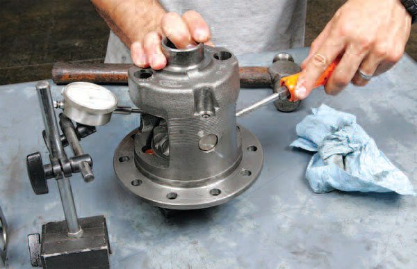 With the gears in place with the clutch, we can check the backlash with a dial indicator.
