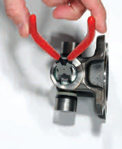 Servicing a snap ring joint is just a matter of getting the correct pliers and compressing the spring. At times, the spring gets stuck in the groove from dirt or rust and may need some persuasion with a screwdriver to loosen the rust and debris.