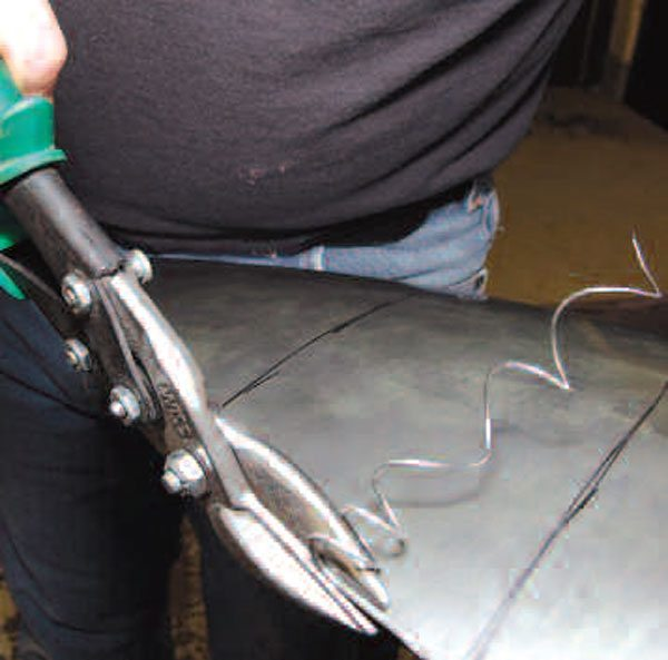 Aircraft snips are great for making accurate cuts in flat sheetmetal, and work well on mildly curved surfaces. They cut reasonably quickly and are relatively inexpensive.