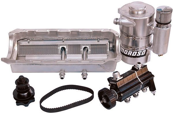 Moroso dry sump oiling systems incorporate a shallow oil pan with multiple pickup points, remote dry sump storage tank with integral breather, multi-stage pump, and drive mandrel with cog belt.