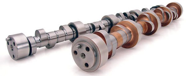 Pro/Stock cam compared to standard roller cam illustrates larger-diameter journals and cam lobes that permit more aggressive profiles with less spring pressure. The larger, stiffer cam maintains more accurate camshaft timing while raised camshaft posi¬tion permits shorter pushrods that deflect less. (Photo Courtesy Comp Cams)