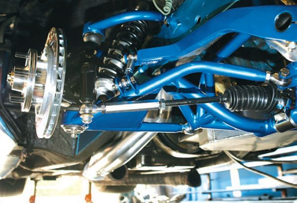 A close-up of the MFR suspension shows that it's a radical departure from the stock format. Coil-overs replace the original torsion bars, making more room for exhaust headers. The crossmember clears even the largest stroker oil pans. Also note the rack-and-pinion steering. (Photo Courtesy Magnum Force Racing)