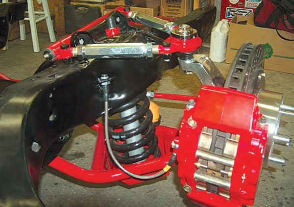 This SPC Performance A-arm package was custom powdercoated by owner Jamie Kimber. The upper arms adjust in the modern fashion with turnbuckles, doing away with shims. The lower arms feature modular spring pockets for adjustable ride height and have revised geometry designed to work with modern alignment specs, lowered ride heights, and modified suspension geometry. Combined with the right tall spindles or tall-ball-joint package, they are amazingly versatile. (Photo Courtesy Jamie Kimber)