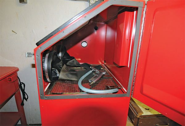 This blast cabinet is big enough to take valve covers, exhaust manifolds, and smaller wheels up to about 15 inches in diameter. This cabinet, with everything you need, can be purchased from Harbor Freight tools.