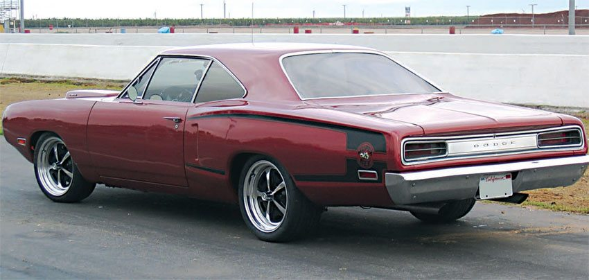 """With tasteful 18-inch-diameter billet-aluminum """"Magnum 500"""" wheels and original-style paint and graphics, this Super Bee pulls off the classic muscle-car look perfectly. The MFR tubular suspension and modern brakes make it perform equal to modern cars in more than just a straight line."""