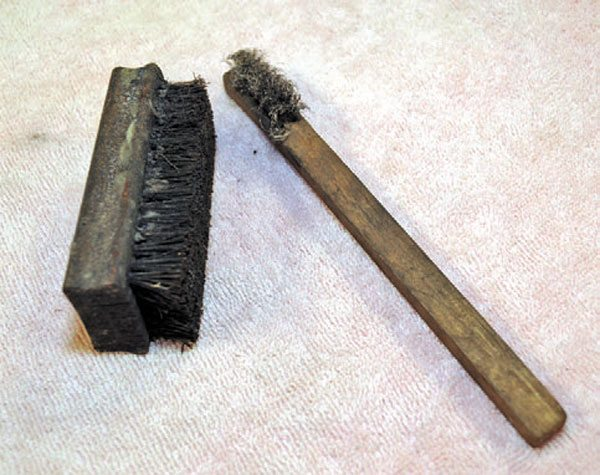 Basic scrubbing brushes are handy. Get a variety of brushes with bristles of brass, plastic, and steel wire.