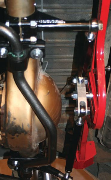 When refinement of a system isn't enough for you, there's always augmentation. The use of Watts links with triangulated four-link suspensions is too new to be widely accepted, but from SCCA American Iron Extreme road racing to autocross and street use, its performance and drivability gains have to be experienced to be believed. Properly implemented, it takes all the skittish behavior out of the factory four-link and replaces it with smooth linear control. This one is being used in conjunction with an SC&C/Hellwig Performance adjustable-rate link-mounted rear sway bar. Its efficient design allows it to generate surprisingly high amounts of roll rate, which can be used to balance the suspension when the Watts is used to lower the rear roll center..