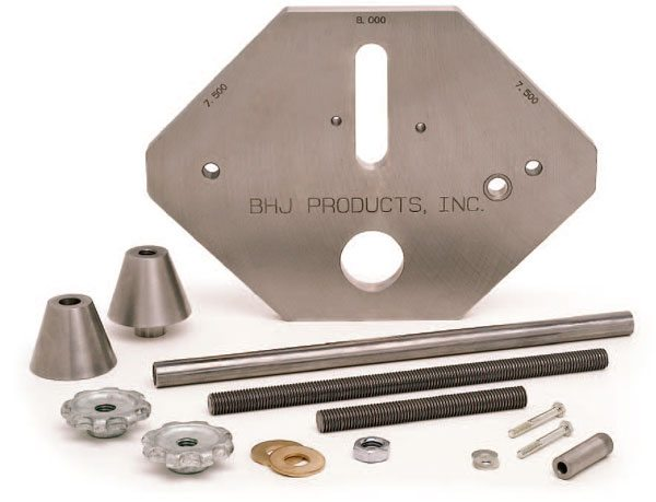 BHJ's Blok-Tru kit aligns deck surfaces to the crankshaft centerline. The precision index plate is machined with 45-degree angles for both deck surfaces. The basic kit is the necessary starting point for tailoring the Blok- Tru system to fit resurfacing machines supplied with a 2-inch-diameter support bar from the manufacturer. It consists of a precision-machined index plate, cam tunnel alignment cones, and cam tunnel clamping hardware. (Courtesy BHJ Products)