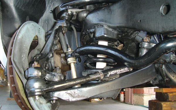 The infamous GM B-body spindle swap. In the mid 1990s, it was the only way to really improve the suspension geometry of 1964 to 1972 A-bodies. But, it trashes the steering geometry, steering ratio, and Ackerman. It adds weight, makes modern brake swaps much more difficult, and widens the track width, which can present wheel fitment issues. Enough people are removing these setups from their cars that some new tall spindles are made as direct B-body swap replacements, and old B-body swap components are getting hard to sell on online auctions. Better than nothing (maybe) in the 1990s, there's a huge selection of better choices available today.