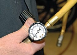 The pressure regulator uses a knob to set the pressure allowed down-stream from the regulator. Set your regulator to the pressure recommended for your gun, then try slightly higher or lower pressures to see what works best with your setup.
