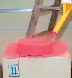 As you spray the powder, move the gun to all areas of the part and give every area equal attention. Thin places may show up and you have to strip and recoat if you give any area less powder than others.