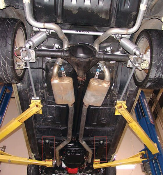Others, like this Nova, are unibody, using complex folded and welded sheetmetal structures for the majority of the body structure with a separate subframe to mount the front suspension, engine, and transmission. You can see the back end of the subframe rails in the highlighted red boxes. (Photo Courtesy RideTech)