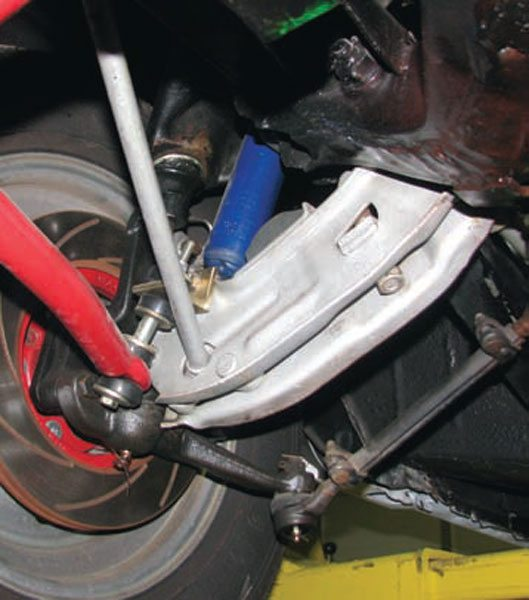 Mopars use a lower arm and strut-rod arrangement similar to many Fords. Some companies, such as RMS, offer strut rods with Heim joints on the front. Firm Feel has boxed lower arms. (Photo Courtesy Ray Campbell)