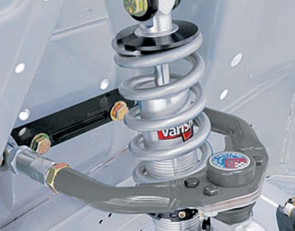 Fords have a similar geometry modification, often referred to as the Shelby mod. The holes directly above the cross shaft mounting bolts are the originals. Drilling jigs are available from Total Control Products for 1964 to 1966 and 1967 to 1973 Mustangs and other Ford vehicles. (Photo Courtesy Total Control Products)