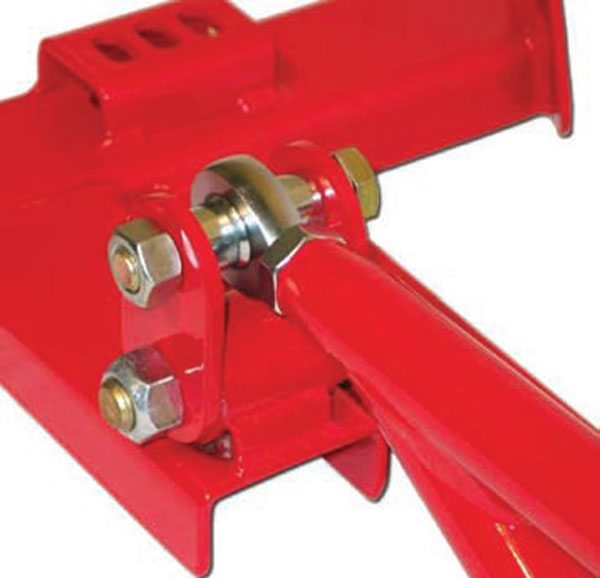 An important point with torque arms is how the front mount must allow the bar to move fore/aft to avoid conflict with the lower trailing arms. This one uses a shackle, and goes one step further with a spherical joint to prevent torsional binding. (Photo Courtesy Spohn Performance)