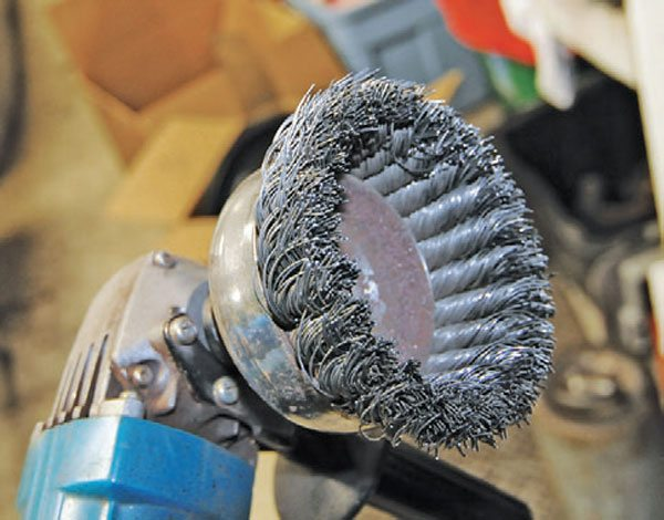 A cup wire wheel has multiple twisted wire brushes. These are fantastic for removing thick coatings of grunge, paint, and anything else. This tool also removes the flesh from your bones nearly instantly, so be careful when using it.