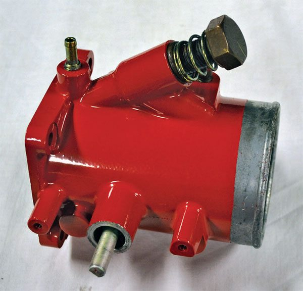 This Ferrari throttle body was cured in the same red powder. You can see that it's nice and smooth, rather than wrinkled.