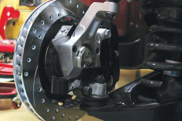 The exotic, and often elusive, AFX tall aluminum spindles were originally designed by Tyler Beauregard for first-gen GM F-bodies. When I did consulting with ATS to design the A-body package for these spindles, my solution was to design new aluminum A-body-specific steering arms to correct the bump steer issues. ATS did a beautiful job of sculpting those raw dimensions in 7075 T6.