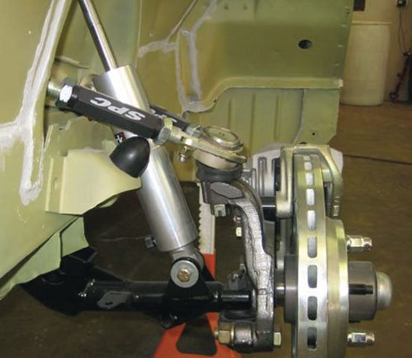 Several companies sell tubular arms for A-, B- and E-body Mopars. Most retain the factory eccentrics for adjustment. A few are single-adjustable and have to be disassembled to adjust the alignment. SPC Performance arms are double-adjustable and the lightest available with their anodized aluminum turnbuckles. Also, note the Varishock QS1 adjustable-rate shocks. There are few good performance shock choices for Mopars—these are one of them.(Photo Courtesy Team Witt Customs)