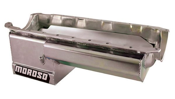 Side kickouts are an effective component of wet sump oil pans, but their efficiency is often compromised by the starter location, which prevents a full-length kickout to control oil coming off the rear crank throws. Internal windage control (right) features rear cutout for the pump and pickup, and a full-length curved windage tray incorporating louvers to direct oil back to the sump. (Courtesy Moroso Performance Products)