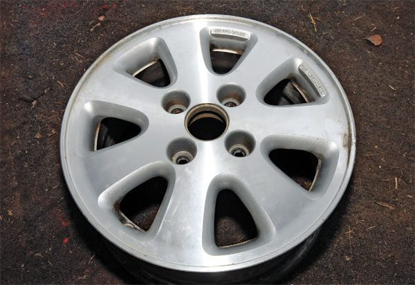 Alloy wheels take a lot of abuse from the weather, UV light, and road hazards. A nice coat of powder is one way to revive an old set of alloys. This Honda wheel can go from boring to beautiful in an hour.