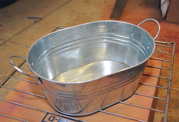 This galvanized tub was meant to be decorative, with a shiny coat of tin over the base metal. I thought it would look good with a two-tone powder coat.