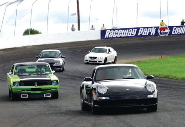A Sublime Green Dart, running next to a Porsche, Mitsubishi EVO, and a BMW?Yep; if it's Justin Mancinco's, believe it. (Photo Courtesy Justin Mancinco)