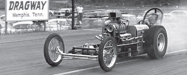 The Coleman-Taylor Automatic Transmissions dragster is seen here blazing the tires at Lake Land Dragway. The blown and injected small-block Chevy motivated the short-wheelbase dragster during the early 1960s, just a couple of years after the strip opened its doors. Many Memphis-area racers used their drag cars to help draw attention to their businesses. (Photo Courtesy Marshall Robilio)