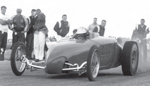 """The famed Speed Sport Roadster was an innovative machine with its mid-engine design and nitro-swilling Hemi, and it's one of the most recognizable drag cars from the late 1950s. You can tell t his is a later photograph of the car because the """"Speed Sport"""" lettering has been changed to """"Howard-Weiand Equipped."""" (Photo Courtesy Larry Rose Collection)"""