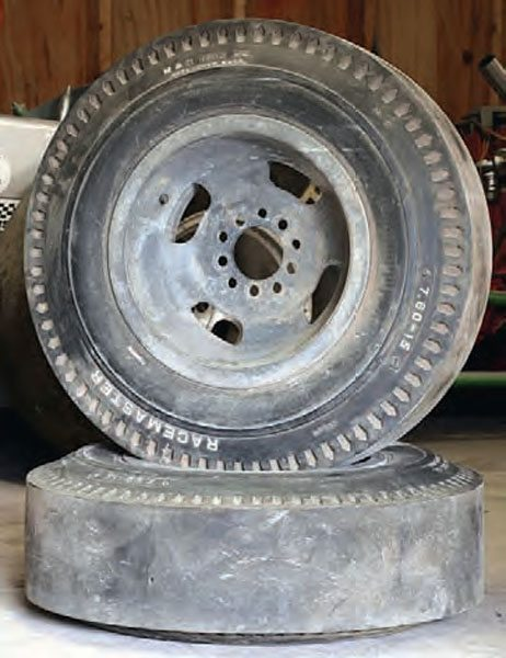 By the mid 1950s, drag racers were desperate for traction, which influenced the development of purpose-built racing tires. Marvin Rifchin manufactured the first slick in 1957, and set the drag racing world on its ear with mind-blowing improvements in elapsed times and speeds. These 7.60- 15 M&H Racemaster tires are mounted to a pair of Romeo Palamides magnesium wheels.