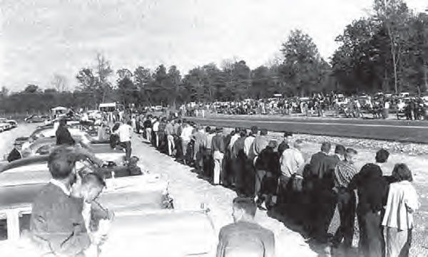 During the 1950s, drag strips drew enormous crowds, even to the smaller tracks that never stood a chance of holding a national event. This photo was taken at Brainerd Optimist Club's first drag strip in Hixson, Tennessee. More than 5,000 spectators entered the track on its opening day. (Photo Courtesy Larry Rose Collection)