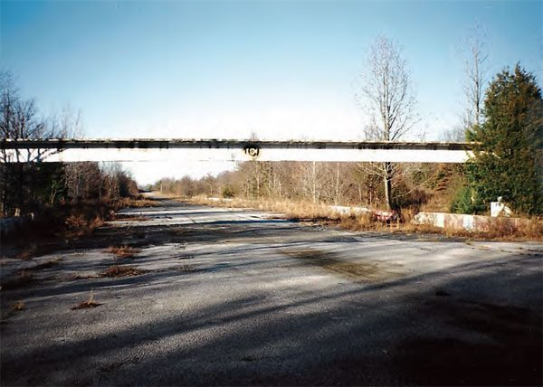 In 1999, the catwalk was still in place, as the track rested peacefully. It got a rude awakening several years later as further development took place. However, the project was halted, and the track still resides behind a factory outlet mall, which has also been shut down and abandoned. (Photo Courtesy Greg Friend)
