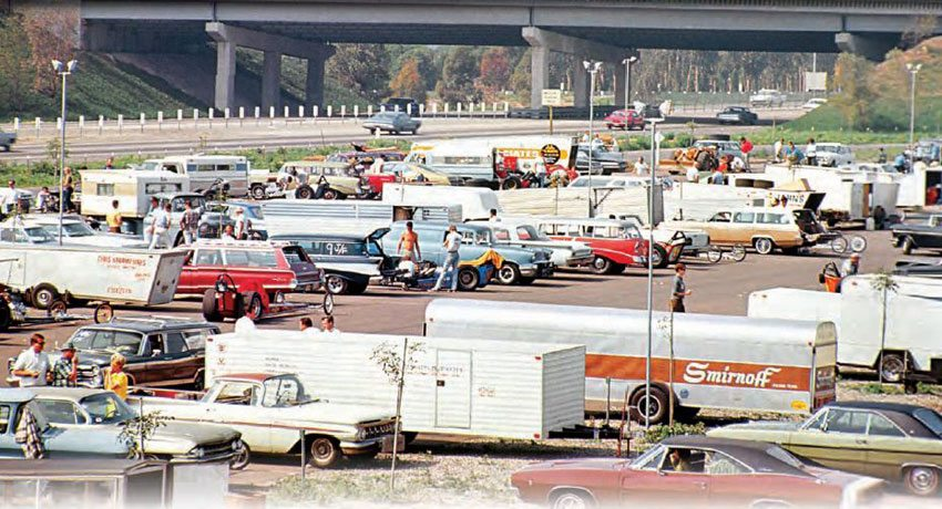 The early days of OCIR can be seen in this shot of the pits. Killer tow vehicles and homemade enclosed trailers are enough to make modern-day hot rodders drool, but it was the race cars that garnered the most attention back then. How many cool station wagons can you spot? (Photo Courtesy Don Gillespie Collection)