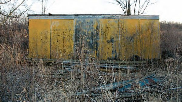 Many of the buildings were not even built when the track was initially opened by the Michigan Hot Rod Association in 1957. The yellow paint is a reminder of this once vibrant drag strip that hasn't been active in more than three decades. (Photo Courtesy www.waterwinter wonderland.com)