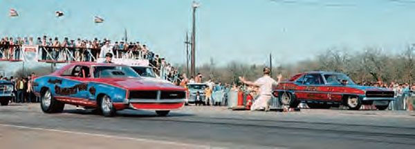 The AHRA sanctioned Green Valley and held many big events at the nationally known facility. Funny cars were the big dogs of the sport and always drew a crowd, especially when a bunch of them rolled into town for a national meet. Here, Gene Snow and Mike Burkhart do battle in 1968. (Photo Courtesy Jay S. Magnum)