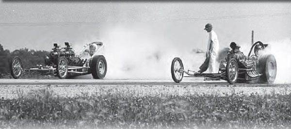 The landscape of the track was unique in that the racing surface was the highest point of the property, making an interesting view for the spectators. Here, a single-engine dragster is facing off against Norbert Locke's twin-flathead– powered dragster at Oswego. The worm's-eye view was great for photographers, as it provided a fantastic low-angle shot. (Photo Courtesy Norbert Locke)