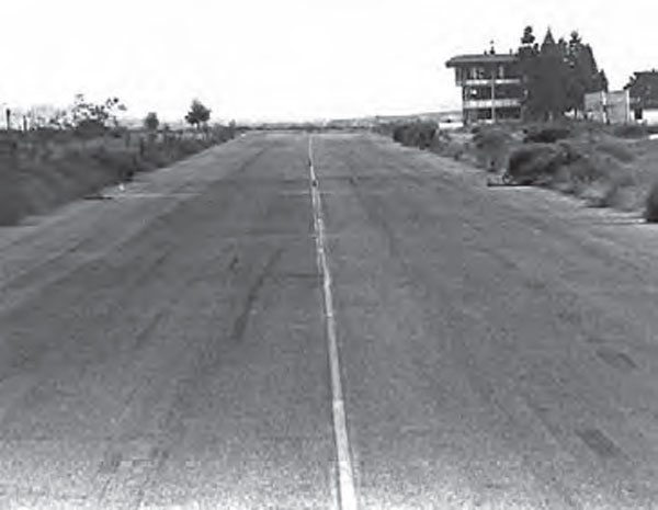 With its guardrails, bleachers, and timing equipment stripped, OCIR sat vacant shortly after its final event in 1983. The track's fi nal manager, Charlie Allen, utilized these components when building Firebird International Raceway in Chandler, Arizona, leaving behind only a strip of pavement and the unforgettable OCIR timing tower. (Photo Courtesy Don Gillespie Collection)