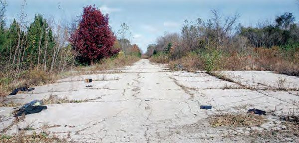 When Oswego Dragway closed in 1979, the track was stripped of its buildings and equipment, leaving only a strip of pavement on the property. The overgrowth was caused by a nursery, which used the property to grow trees for several years. The property has now been annexed into the city of Oswego and zoned as commercial. (Photo Courtesy Greg Rourke)