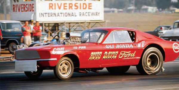 In this fantastic shot of Gas Ronda's Mustang funny car battling an injected dragster in the far lane, you can see the Riverside timing tower in the background. It's also a great stop-action shot as the blown funny car wrinkles its Goodyear Blue Streak slicks off the line. (Photo Courtesy Don Gillespie Collection)