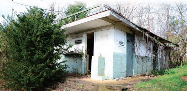The restrooms are still intact atop the hill on the right side of the track. They are now essentially located in someone's back yard. All of the buildings at the old Hudson Drag Strip are still standing—it's as if the owners simply turned out the lights and walked away.